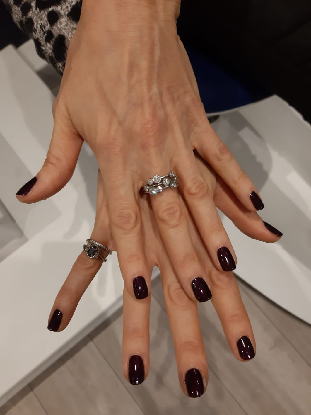 hands with dark red nail polish